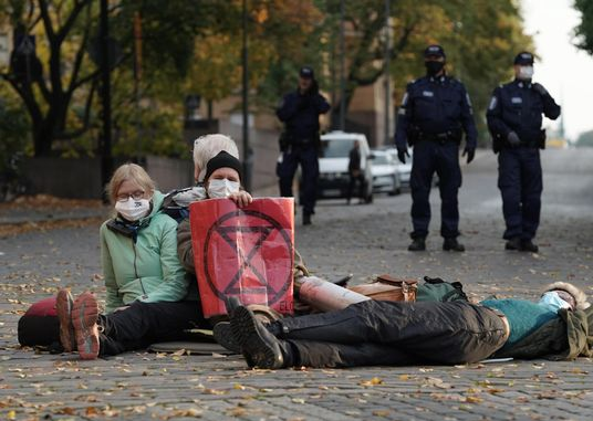 Extinction Rebellion activists protested by stopping traffic in central Helsinki in October before they were moved on by police using pepper spray.