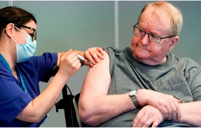 Svein Andersen, 67, is first in Norway to receive the Pfizer-Biontech COVID-19 vaccine in Oslo, Norway