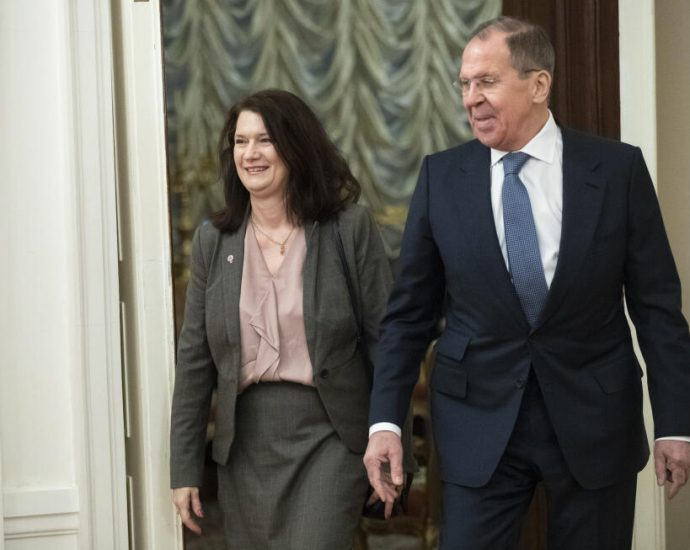 Russian Foreign Minister Sergey Lavrov, right, and Sweden's Foreign Minister Ann Linde enter the hall during their meeting in Moscow, Russia, Tuesday, Feb. 4, 2020.